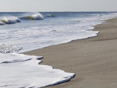 Spraying Surf Rolls Toward the Beach by Mauricio Handler