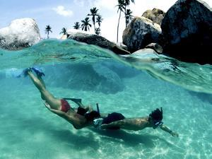 Two Snorkelers Explore the Baths in Virgin Gorda by Mauricio Handler