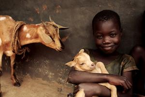 Child Holding a Kid by Mauro Fermariello