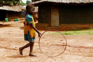 Child Playing by Mauro Fermariello