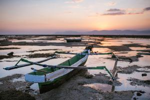 A Fisherman Boat at Low Tide Sunset by Max Lowe