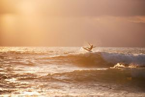 A Kid Surfer Airs Out of a Little Wave at Lakey Peak by Max Lowe