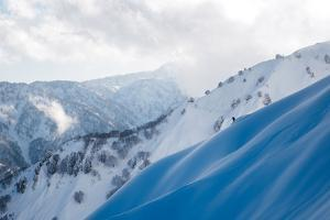 A Snowboarder Cuts a Turn into a Slope in the Backcountry Near Takayama by Max Lowe