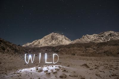 "A Time Exposure of the Word ""Wild"" Written Beneath the Peak of Mount Everest"
