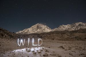 """A Time Exposure of the Word """"Wild"""" Written Beneath the Peak of Mount Everest by Max Lowe"""