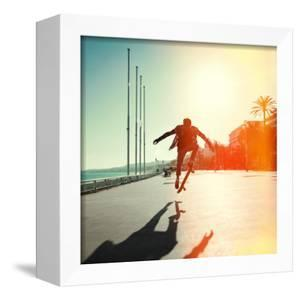 Silhouette of Skateboarder Jumping in City on Background of Promenade and Sea by Maxim Blinkov