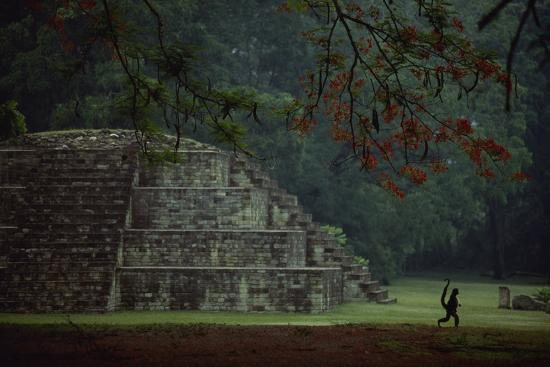Mayan pyramidal tomb showing silhouetted Pancho the monkey who lives at the site.-Kenneth Garrett-Photographic Print