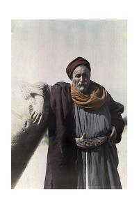 A Nomad Chief Stands with Ruins at the Site of Old Tiberias by Maynard Owen Williams