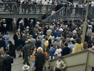 Commuters Crowd a Ferry Landing During Rush Hour