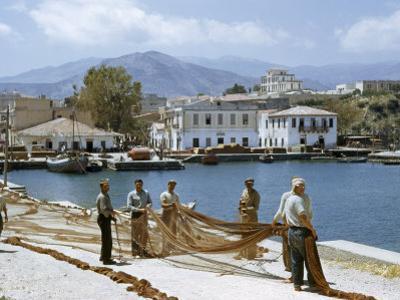 Fishermen Spread their Nets on Sun-Baked Wharves