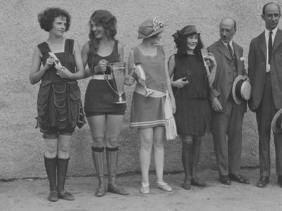 Girls in Summery Attire Hold Cup, Ribbons, and Awards They've Won