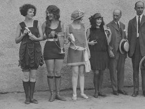 Girls in Summery Attire Hold Cup, Ribbons, and Awards They've Won by Maynard Owen Williams