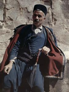 Man Poses in the National Costume of Crete by Maynard Owen Williams