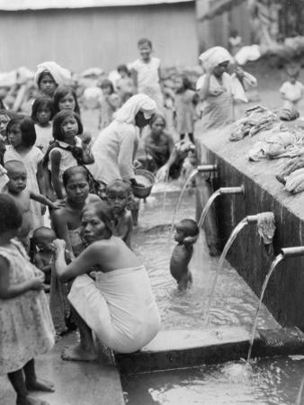 Moslem Women Attend a Ceremonial Bathing Spot