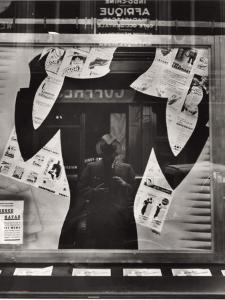 Photographer's Reflection in a Cut-Out Silhouette in a Window by Maynard Owen Williams