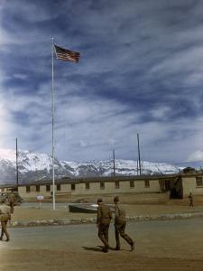 Soldiers Walk across Dirt Yard at Camp Amirabad Outside Tehran by Maynard Owen Williams