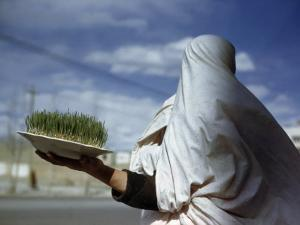 Woman Holds Plate Containing New Grain Sprouts to Celebrate New Year by Maynard Owen Williams