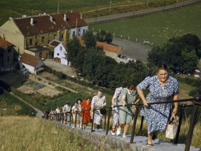Women Hold onto Railing When Climbing Up Waterloo's Memorial Mound