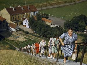 Women Hold onto Railing When Climbing Up Waterloo's Memorial Mound by Maynard Owen Williams