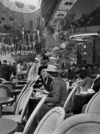 Women Relaxing at a Sidewalk Cafe