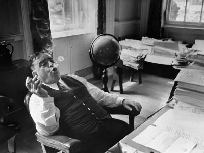 Mayor Fiorello LaGuardia Blowing Smoke Rings Sitting at Desk in His Office-William C^ Shrout-Photographic Print