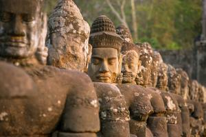Stone Carved Statues of Devas on the Bridge to Angkor Thom in Angkor Complex, Siem Reap, Cambodia by mazzzur