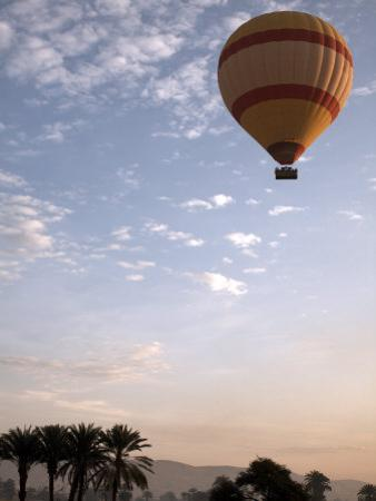 Hot Air Balloons Carry Tourists on Early Morning Flights over the Valley of the Kings, Luxor, Egypt by Mcconnell Andrew
