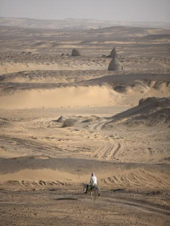 Man on Mule-Back Traverses the Desert around the Ancient City of Old Dongola, Sudan, Africa by Mcconnell Andrew