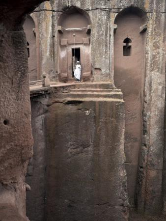 Priest Stands at the Entrance to the Rock-Hewn Church of Bet Gabriel-Rufael, Lalibela, Ethiopia by Mcconnell Andrew