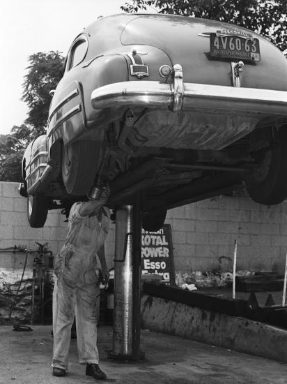 Mechanic Working on Underside of Car-George Marks-Photographic Print