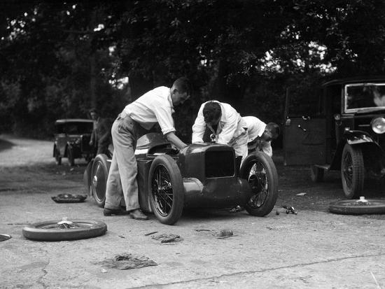 Mechanics working on Leon Cushmans Austin 7 racer for a speed record attempt, Brooklands, 1931-Bill Brunell-Photographic Print