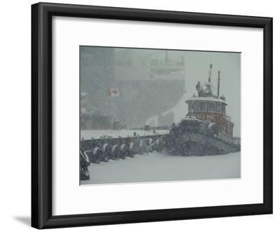 A Tugboat and Freighter at Dock in a Snowstorm