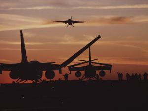 Silhouetted Planes on an Aircraft Carrier at Twilight by Medford Taylor