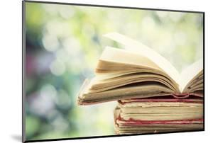 Close up on Old Book on Colorful Bokeh Background by melis