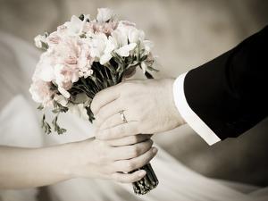 Groom Handing Wedding Bouquet to Bride by melis