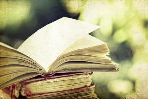 Vintage Photo of Old Books on Colorful Bokeh Background by melis