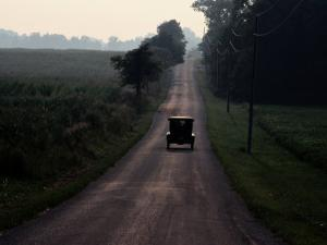 A 1925 Model T Drives Down an Old Strip of the National Road by Melissa Farlow
