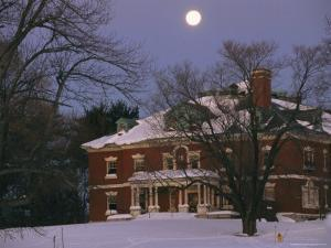 A Full Moon Rises Over a Snow-Covered Mclean Hospital Building by Melissa Farlow