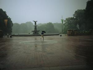 A Man Scurries Across Bethesda Terrace During a Rain Shower by Melissa Farlow
