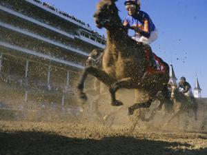 Close Action Shot of Horses Racing in the Kentucky Derby by Melissa Farlow
