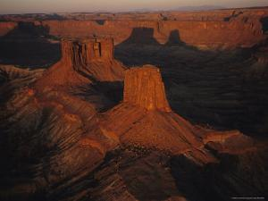 Dawn over the Buttes of the Cross and Their Shadows on Rock Cliffs by Melissa Farlow