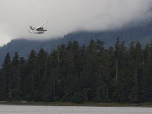 Float Plane Takes Off from the Fishing Village of Craig on Prince of Wales Island, Craig, Alaska by Melissa Farlow