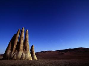 Giant Hand Sculpture Rises from the Sands of the Atacama Desert by Melissa Farlow