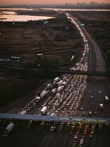 Hundreds of Cars Line up to Pay a Toll on the New Jersey Turnpike by Melissa Farlow