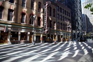 Morning sunlight reflections dapple W. Adams Street near Berghoff restaurant. by Melissa Farlow