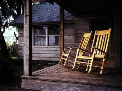 Seaside Cottage with a Pair of Rocking Chairs on its Porch by Melissa Farlow
