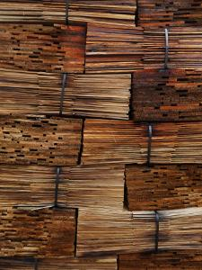 Stacked red cedar shakes by Melissa Farlow