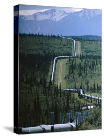 The Trans-Alaska Pipeline Cuts Through Wilderness Towards Mountains