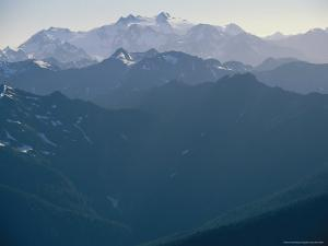 Twilight View of Snow-Capped Olympic Mountains by Melissa Farlow