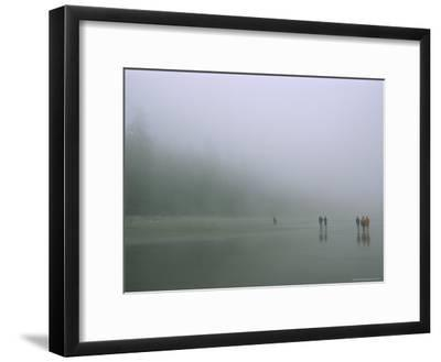 Walkers on a Fog-Shrouded Beach at Low Tide